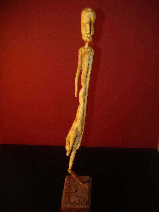 "Spain , Artist : Juan Vivanco Toribio, Title: Hunger , Date Year 2006 Caption : "" Human figure . Injustice has cut trought him leaving its indelible marks. These last forever. He is holding on to life with the fine thread that holds him."""